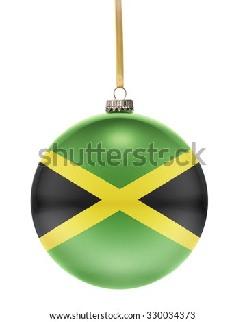 A glossy christmas ball in the national colors of Jamaica hanging on a golden string isolated on a white background.(series) - stock photo