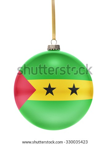 A glossy christmas ball in the national colors of Sao Tome and Principe hanging on a golden string isolated on a white background.(series) - stock photo