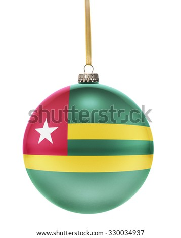 A glossy christmas ball in the national colors of Togo hanging on a golden string isolated on a white background.(series) - stock photo