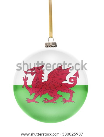 A glossy christmas ball in the national colors of Wales hanging on a golden string isolated on a white background.(series) - stock photo