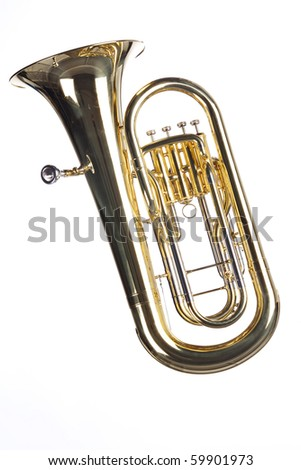 A gold brass tuba euphonium isolated against a white background in the vertical format. - stock photo