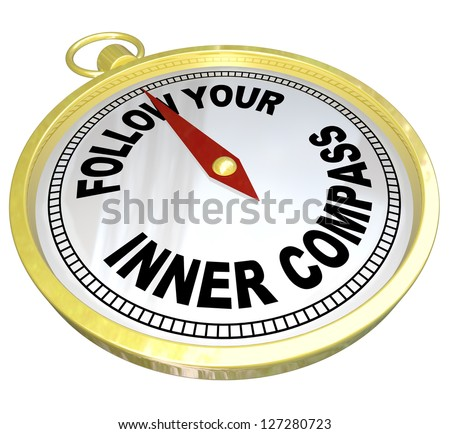 A gold compass with the words Follow Your Inner Compass directing you to success with confidence and determination - stock photo