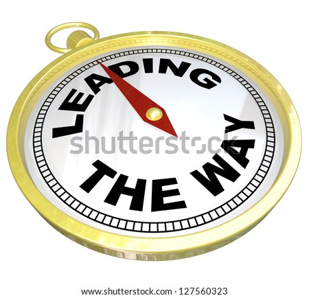 A gold compass with the words Leading the Way illustrating the forward charging path of a visionary leader who must lead his or her group through a challenge to success - stock photo