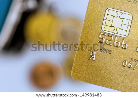 a gold credit card and an empty wallet. symbolic photo for cashless transactions and status symbols. - stock photo