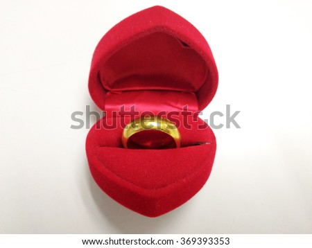 A gold ring in a heart-shaped box, gift for Chinese New Year and Valentine's day - stock photo