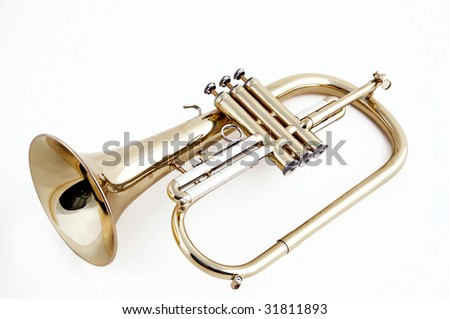 A gold trumpet flugelhorn isolated against a white background in the horizontal format. - stock photo