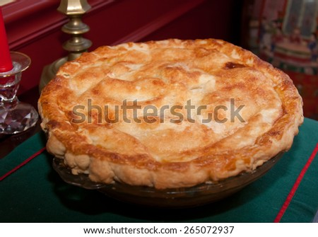 A golden brown homemade pie for Christmas Dinner - stock photo