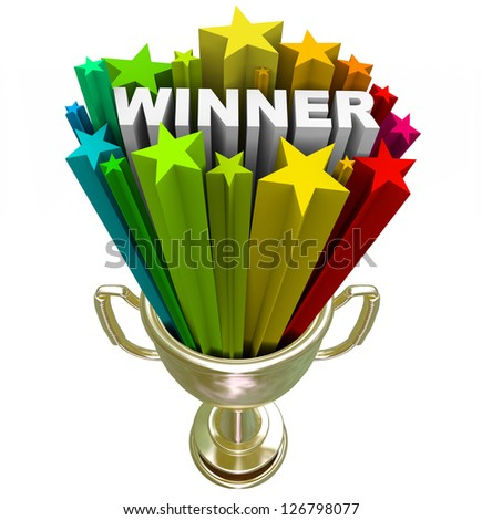 A golden first place trophy with the word winner and colorful stars shooting out of it, symbolizing winning a competition - stock photo