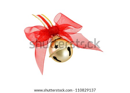 A golden jingle bell is a traditional Christmas symbol shown here with a decorative red bow isolated on a white background - stock photo