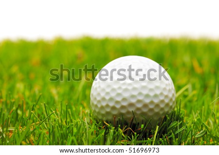 A golf ball on a green grass against white background - stock photo