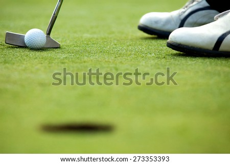 A golf club on a golf course - stock photo