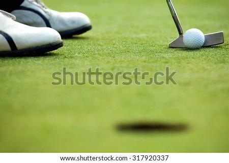 A golf club on a golf course - stock photo