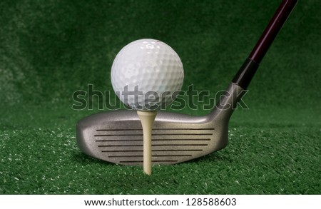 A golf club prepares to drive a Teed up Ball - stock photo
