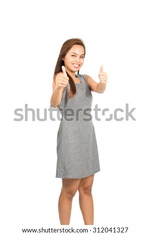 A good looking Asian woman light brown hair in gray sleeveless dress enthusiastically approving with two thumbs up giving blessing or compliment of good job or product. Thai national of Chinese origin - stock photo