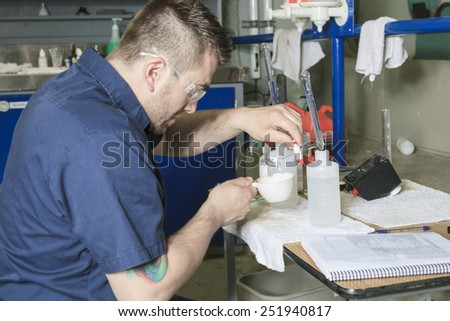 A good serviceman working on a machine room - stock photo
