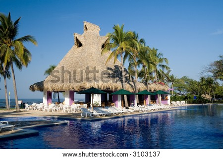 A gorgeous poolside restaurant at a tropical resort in El Salvador - stock photo