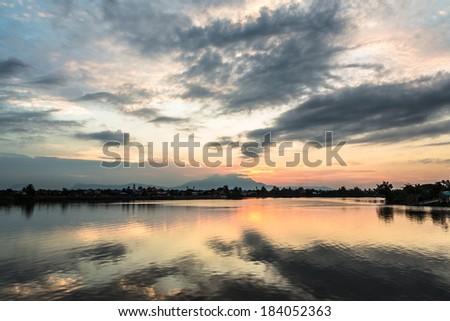 A gorgeous sunset over the Kuching river (sungai) in the city of Kuching in Sarawak, Malaysia Borneo - stock photo