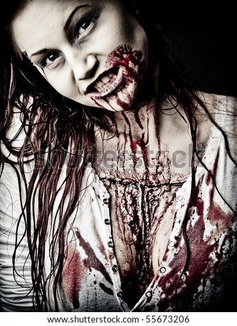 a gory bloody and scary zombie girl - stock photo