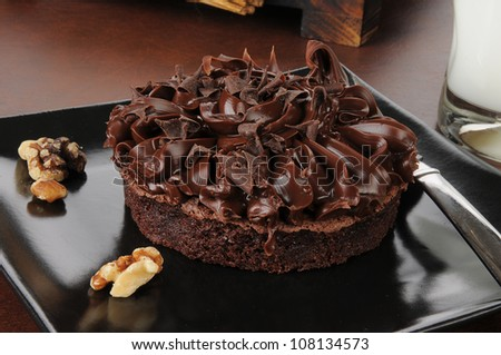 a gourmet brownie with walnuts, chocolate shavings and milk - stock photo
