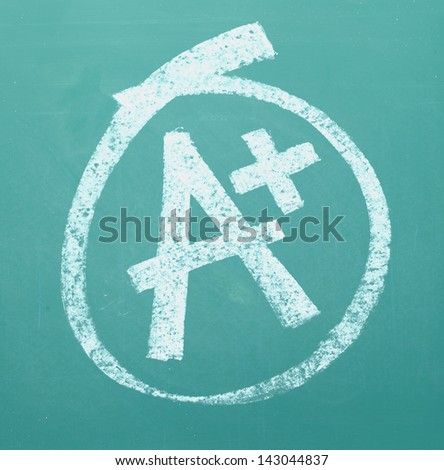 A grade drawn and circled on a chalk board. - stock photo