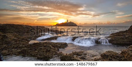 A great evening at Godrevy overlooking the Godrevy Lighthouse in Cornwall, England, UK - stock photo