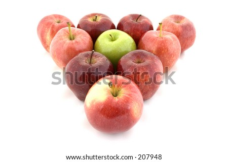 A green apple in a triangle of red - stock photo
