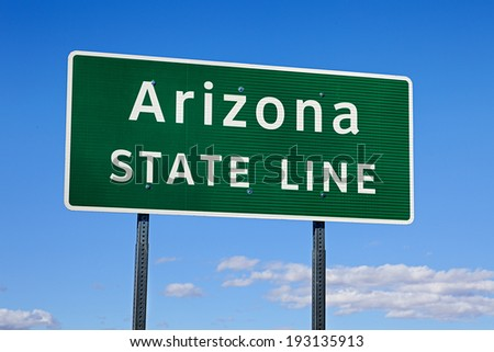 A Green Arizona State Line Road Sign - stock photo