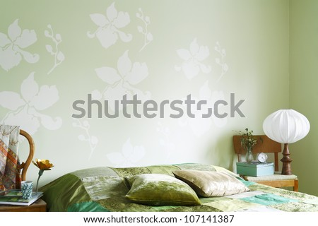 A green bedroom. - stock photo