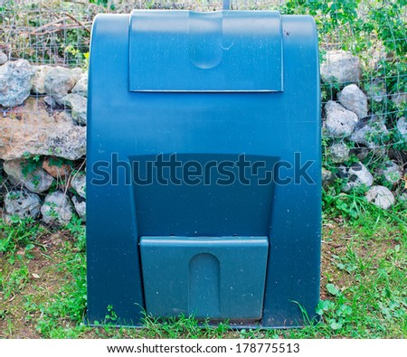 a green composter in the garden - stock photo