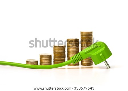 A green electricity plug with stack of golden coins / Green energy creating wealth concept - stock photo
