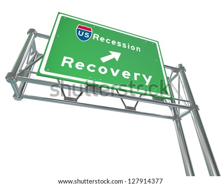 A green freeway sign against white background with the words US Recession - Recovery - stock photo