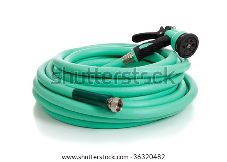 A green garden hose with a sprayer on a white background - stock photo