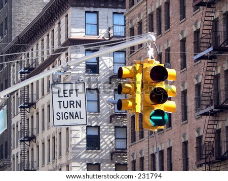 A green light to turn left in New York City. - stock photo