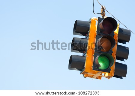 A Green light traffic signal with blue sky copy space - stock photo