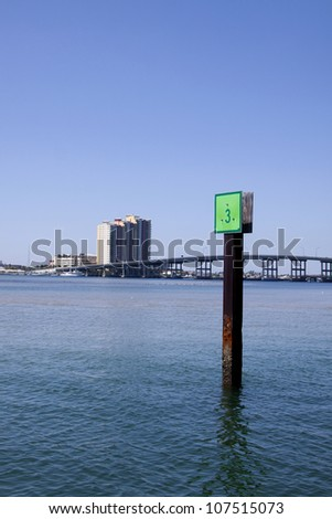 A green marker in the water of the Intracoastal Waterway near West Palm Beach, Florida. - stock photo