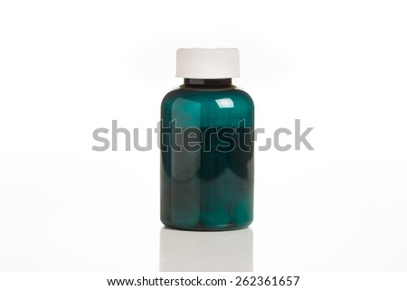 A Green Pill Bottle Isolated on a White Background. - stock photo