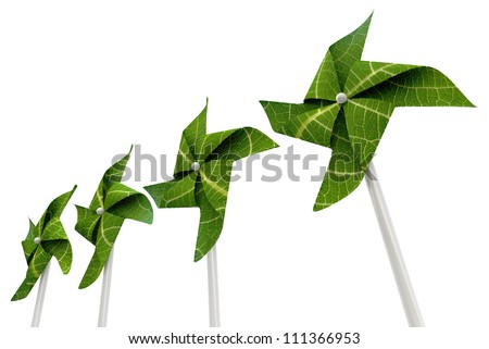 A green windmill made out of leaves isolated on a white background - stock photo