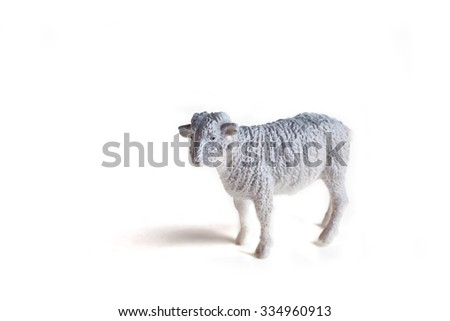 A grey sheep plastic toy for kids isolated on white background - stock photo