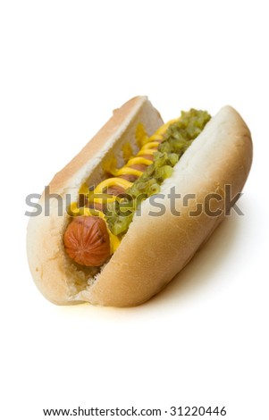 A grilled hot dog on a bun with relish and mustard. - stock photo