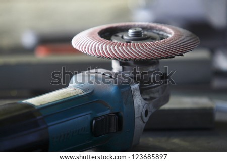 A grinder on a factory table - stock photo