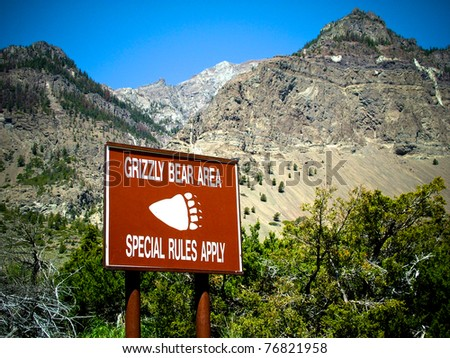 A Grizzly Warning sign informs visitors to northern Wyoming of bear threats. - stock photo