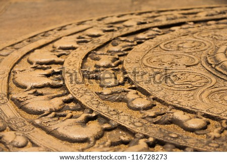 A ground carving at the entrance to the Vatadage is a moonstone relief depicting the cycle of sansara in the ruins of ancient capitol of Polonnaruwa, Sri Lanka. Side - stock photo