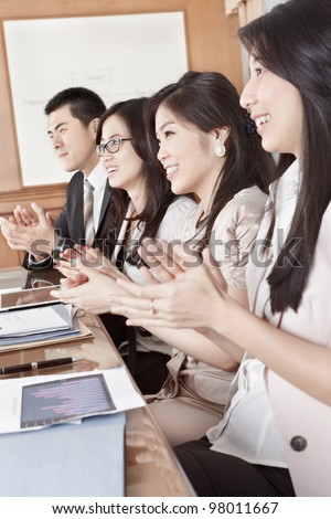 A group business people clapping their hand while on meeting in the office - stock photo