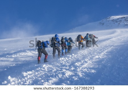 A group of alpinists on their way to the Elbrus - stock photo