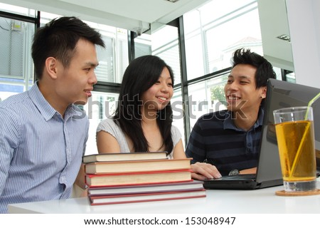 A group of Asian college students studying at a cafe - stock photo