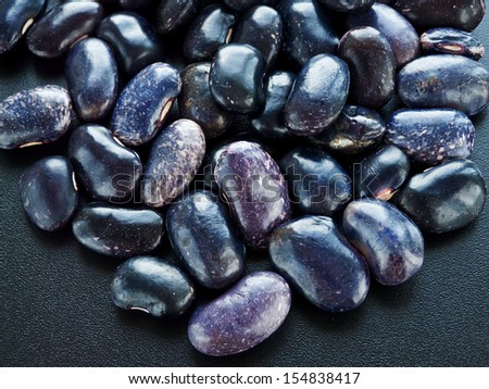 A group of blue and purple marble beans. Shallow dof. - stock photo