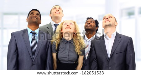 A group of business people in the office. Look to the top. - stock photo