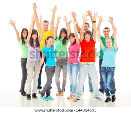 A group of cheerful people posing with their arms up. - stock photo