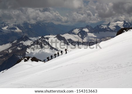 A group of climbers ascending Elbrus - stock photo