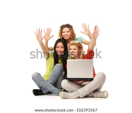 A group of college friends with a laptop - stock photo